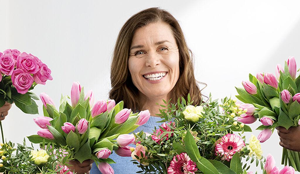 Fira mamma med blommor på mors dag